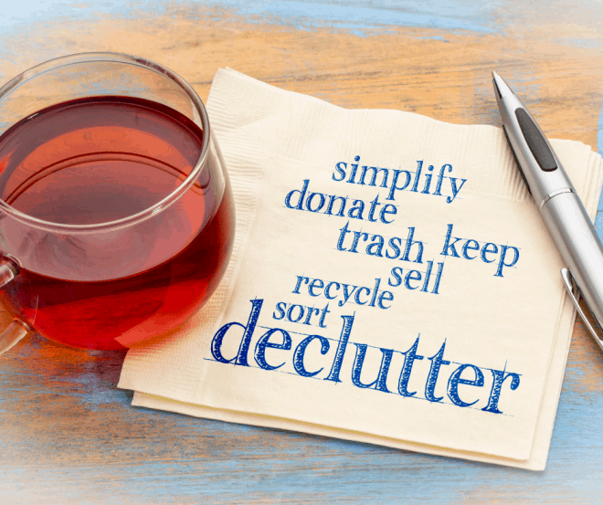 Summer Breeze - napkins with words on how to declutter next to a glass of wine