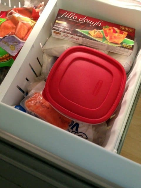 Pour mixture into freezer proof container , cover and freeze for at least five hours.