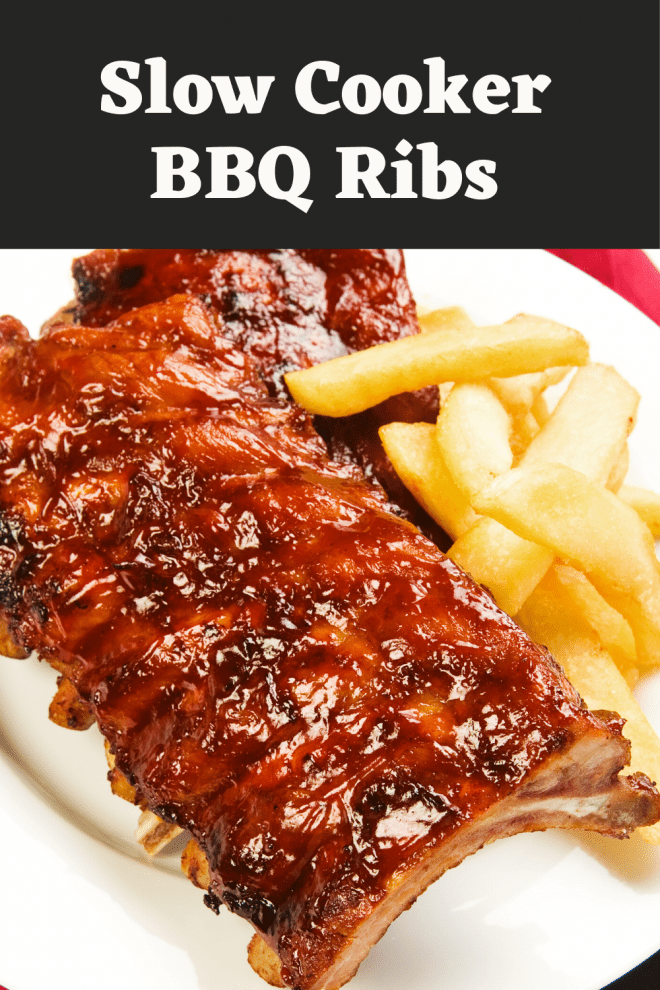 Slab of BBQ Ribs on a white platter with french fries