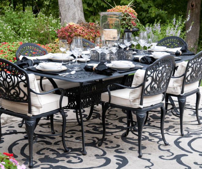 Table Set For A Garden Party - Black Table With Flowers For A Centerpiece