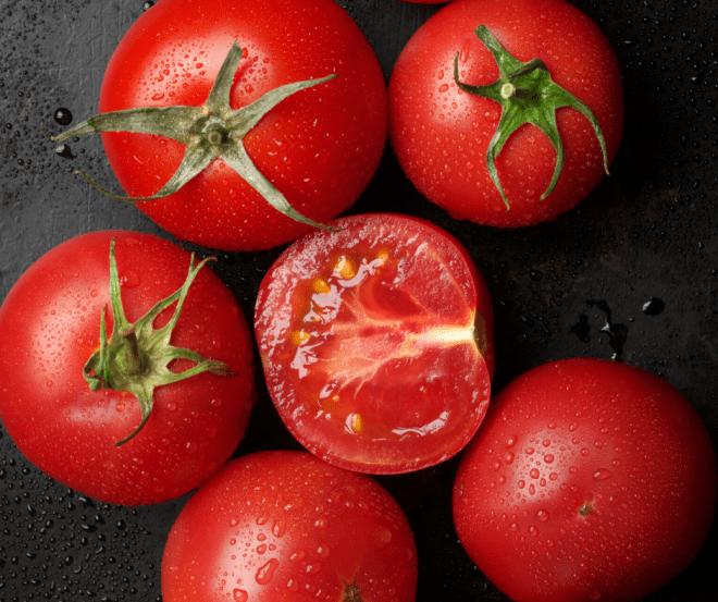 tomatoes on black background