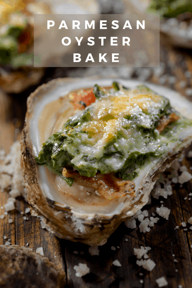 Parmesan topped oyster in the half shell placed on a bed of sea salt
