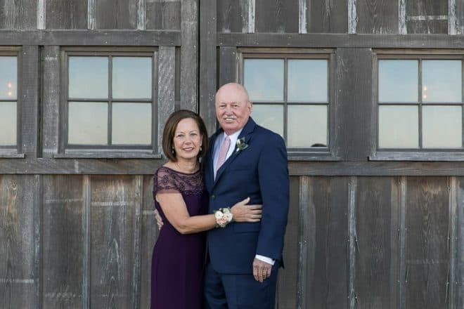 my brother and sister-in-law, Patty, standing in front of a barn