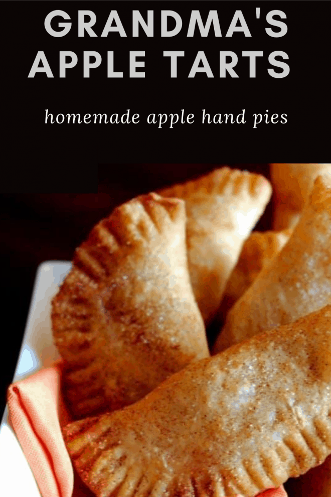 Grandma's Apple Tarts placed in a white bowl with an orange napkin