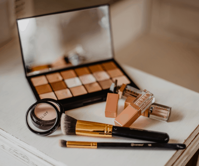 makeup tips for age 50 and up - including eye shadow and brushed on a white case