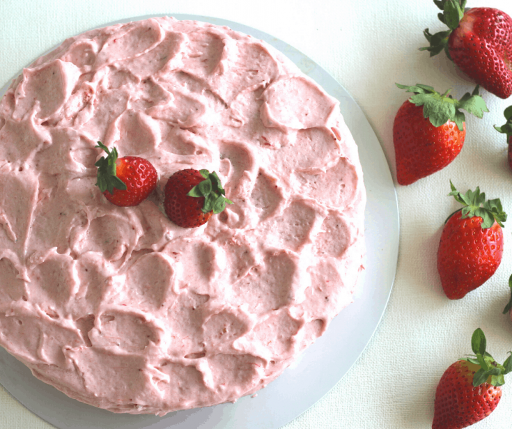 Strawberry Lemonade Cake with strawberries on the side