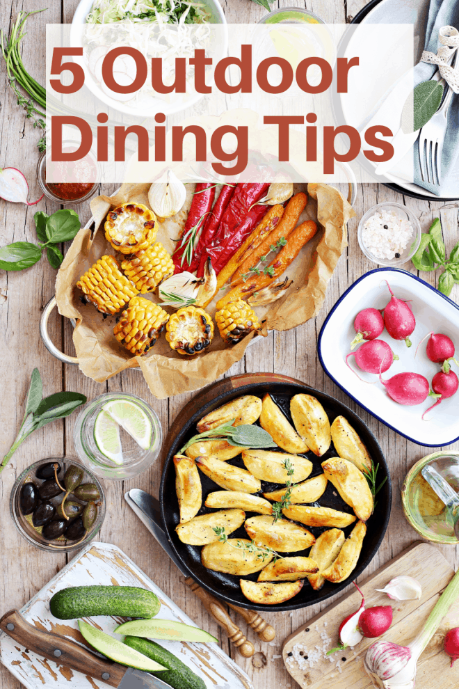 5 Outdoor Dining Tips - A wooden table filled with grilled party foods