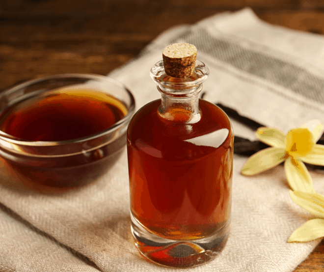 Homemade Vanilla Extract in glass bottle with cork