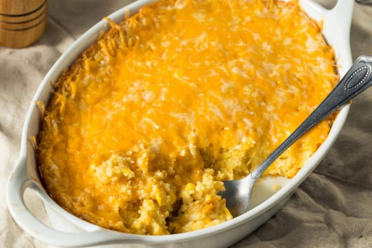 Mexican Corn Casserole in White Dish With Spoon