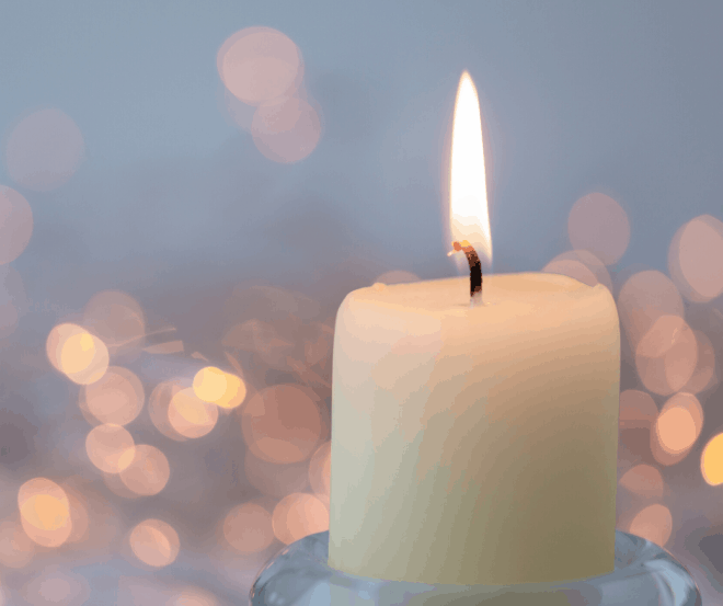 White Candle with blurry background