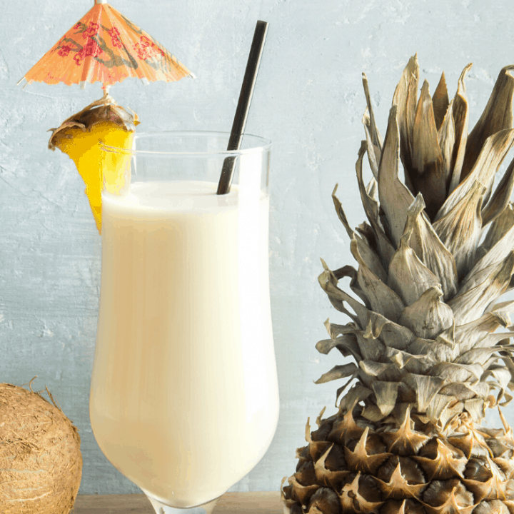 Breakfast Pina Colada in tall glass garnished with pineapple wedge and umbrella