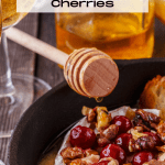Baked Brie topped with walnuts and cherries