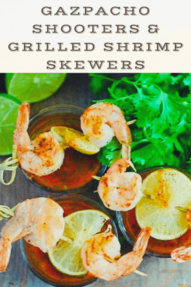 Chilled Gazpacho served in shot glasses and topped with grilled shrimp and lime skewers