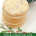 A stack of Milk Chocolate Toffee Butter Cookies on a white plate