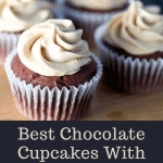 Chocolate Cupcakes With Peanut Butter Frosting on a wooden cutting board