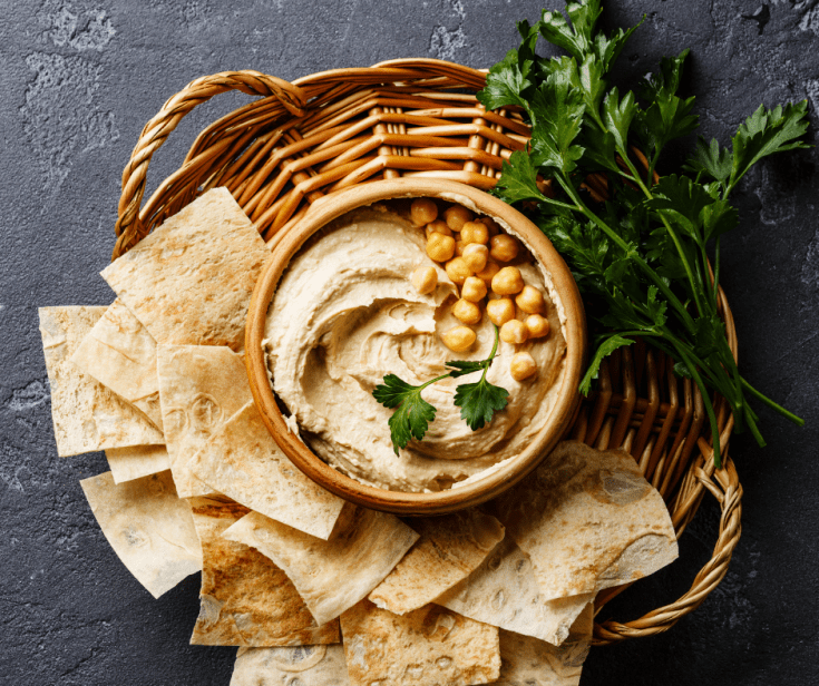 Easy Homemade Hummus served with pita chips in a basket