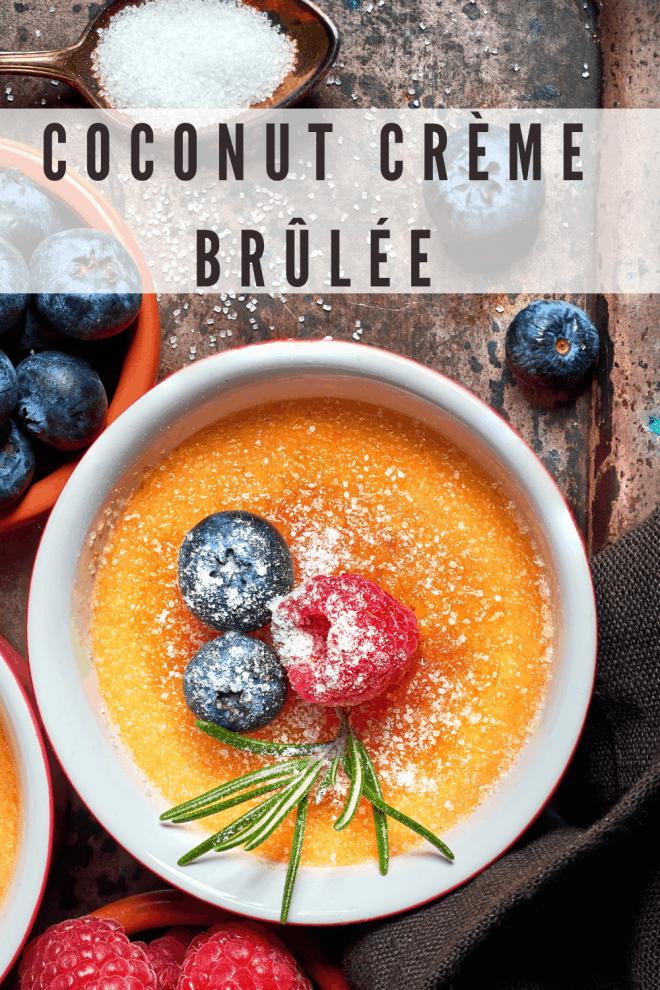 Coconut Crème Brûlée in ramekin topped with berries