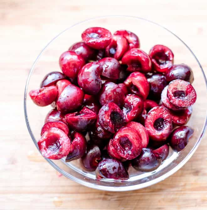 Pitted cherries in a glass bowl