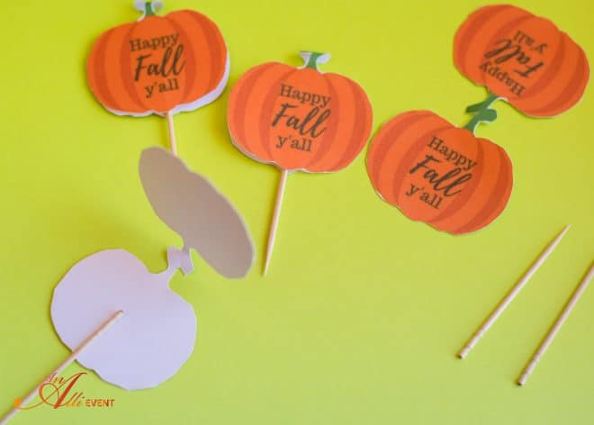 Add cupcake toppers to DIY Fall Cupcake Baskets