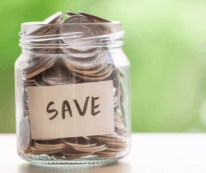 glass jar full of coins with the word save on the front