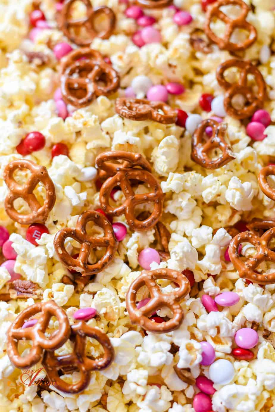 White Chocolate Covered Popcorn With Pecans And Pretzels
