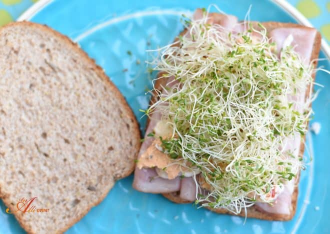 Add the sprouts to the Mediterranean Sandwich