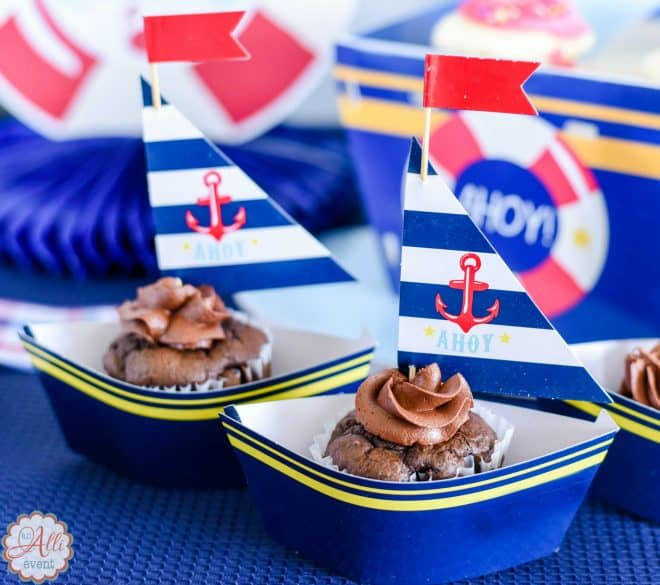 nautical baby shower featuring cupcake wrappers and picks