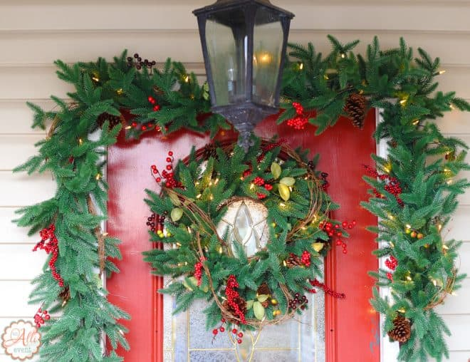 Lighted Garland and Front Door Wreath adds a pop of color to my porch.