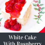 Festive White Cake With Raspberry Sauce on a serving platter