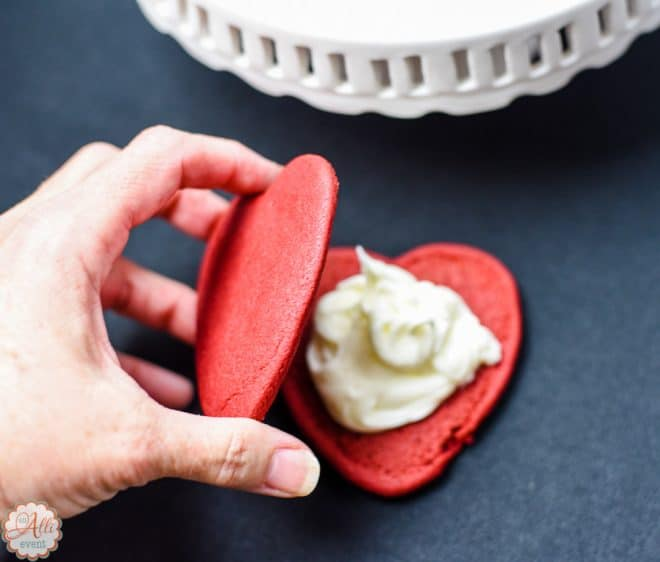 Sandwich the frosting between the Red Velvet Heart Shaped Cookies