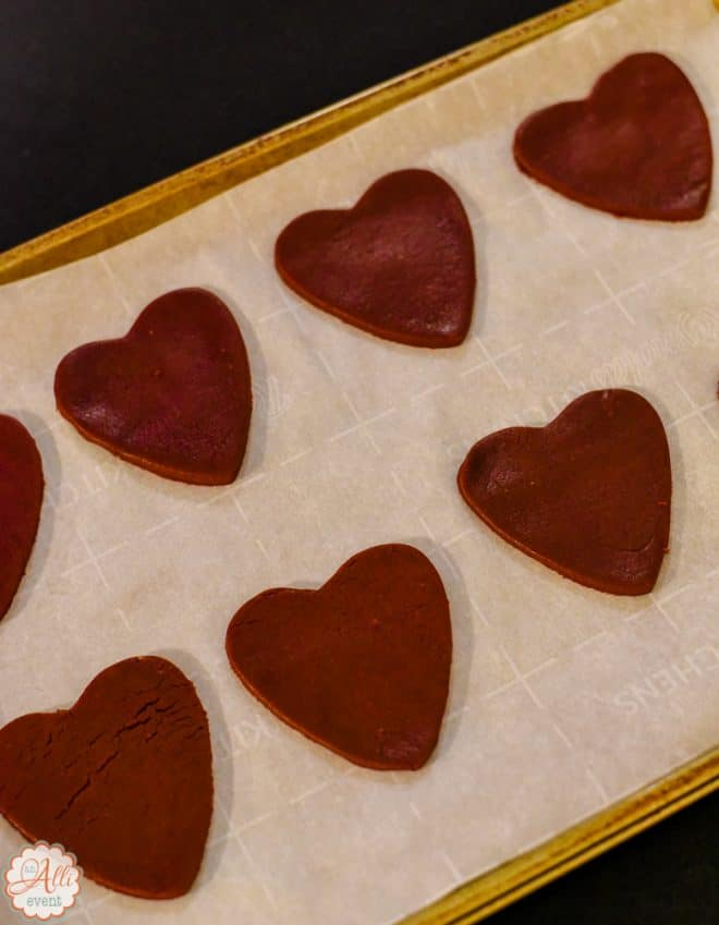 Rolled out Red Velvet Heart Shaped Cookies