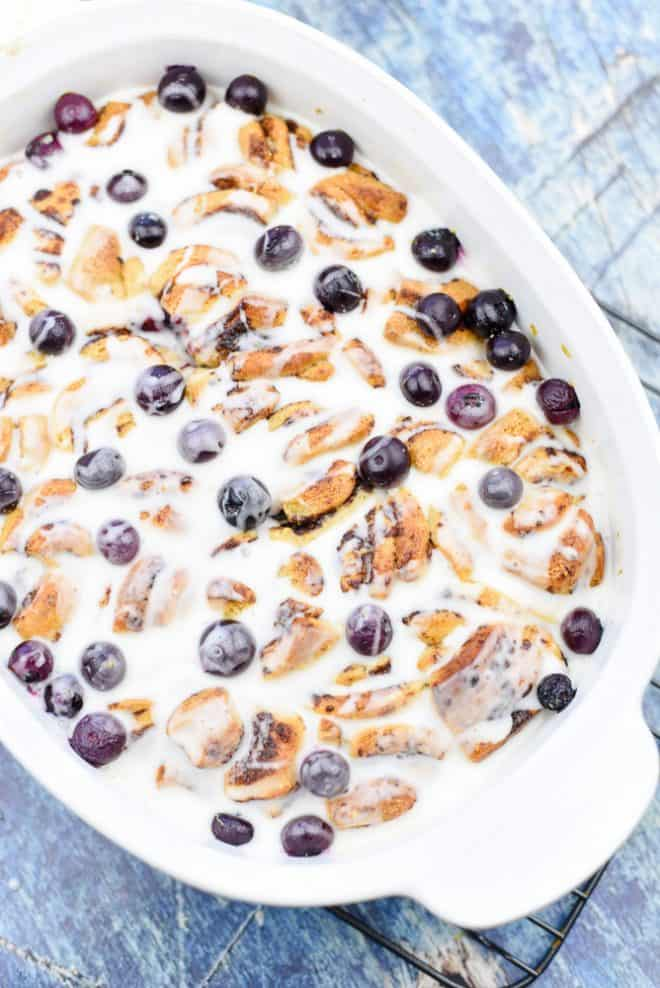 Pour Glaze over Lemon Blueberry Cinnamon Roll Bake