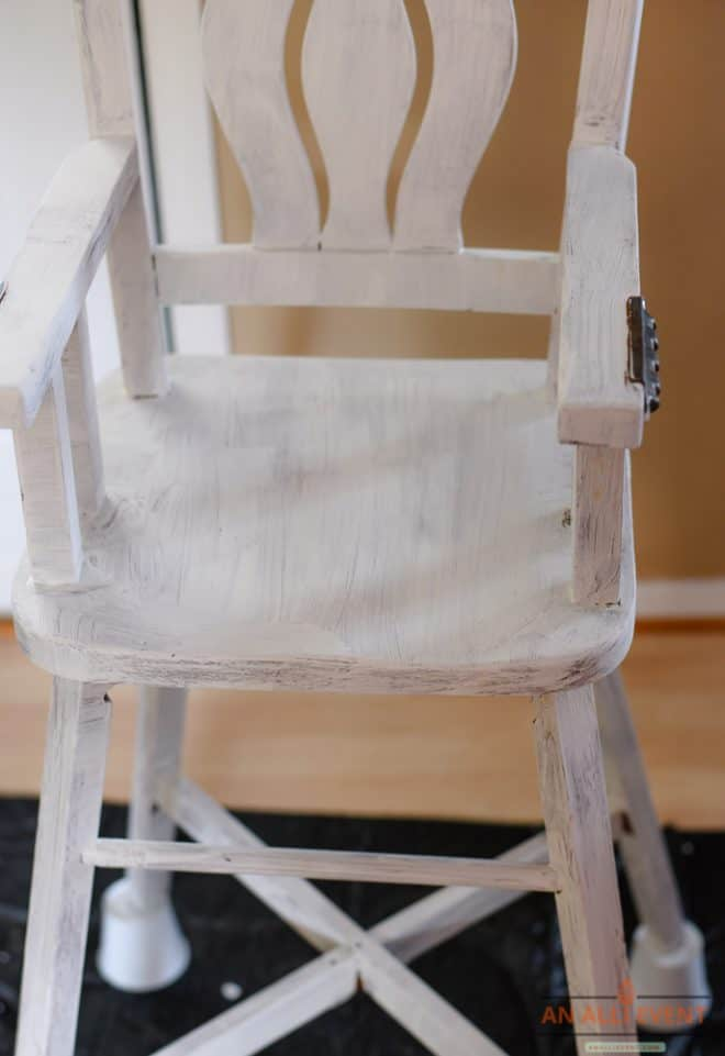 High Chair Makeover - After one coat of paint