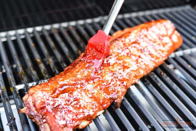 Adding Glaze to Cherry-Apple Glazed Grilled Ribs