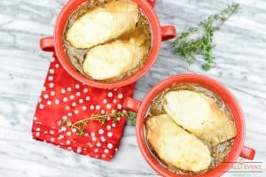 Bowls of French Onion Soup topped with baguette and cheese