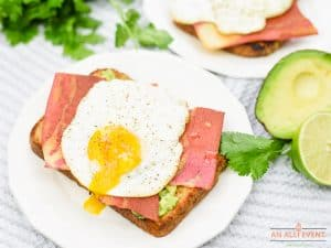Easy Avocado Toast Topped with Bacon Strips and a Fried Egg