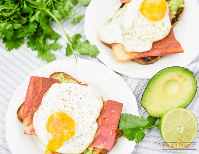 Easy Avocado Toast topped with Bacon Strips and a fried egg.