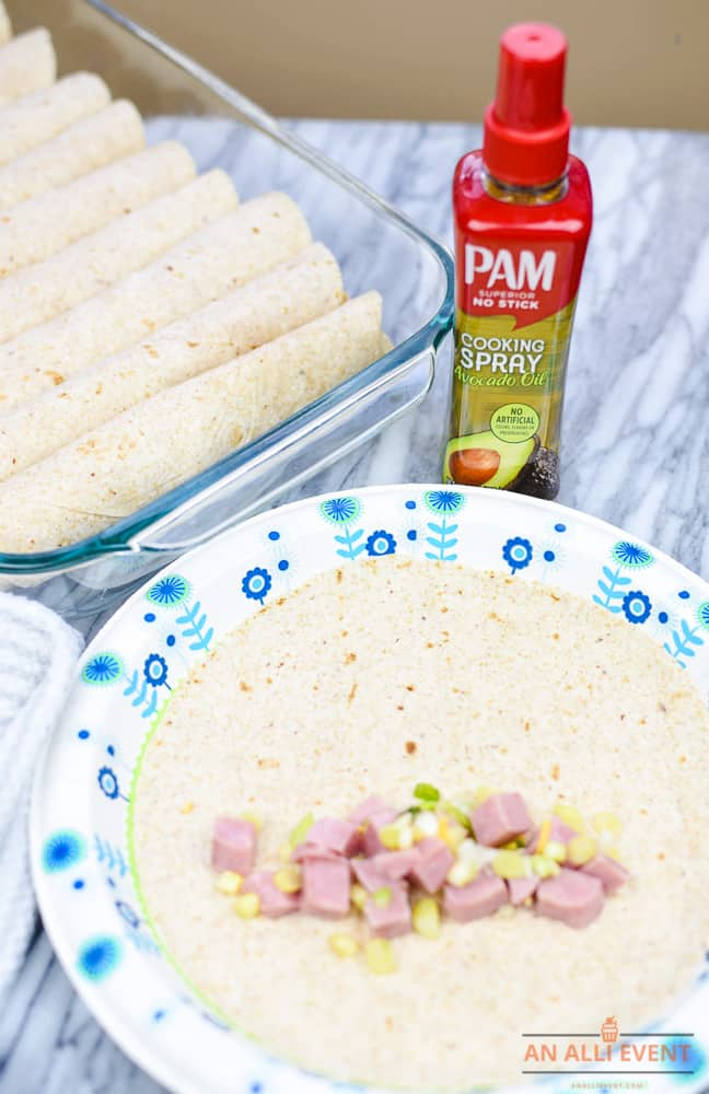 Add ham and onions to each tortilla to make Breakfast Enchiladas