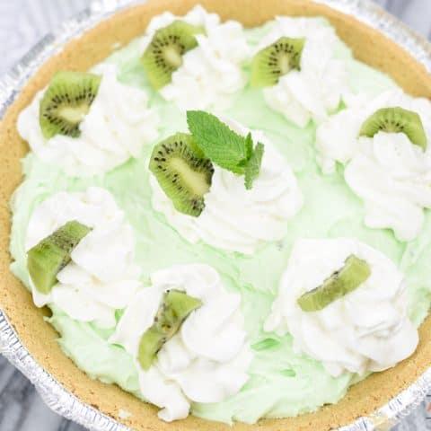 Kiwi Pistachio Pie Topped With Whipped Cream and Kiwi Fruit