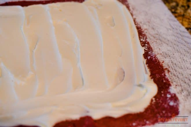 Spread cream cheese filling to within an inch on all sides of the cake roll.