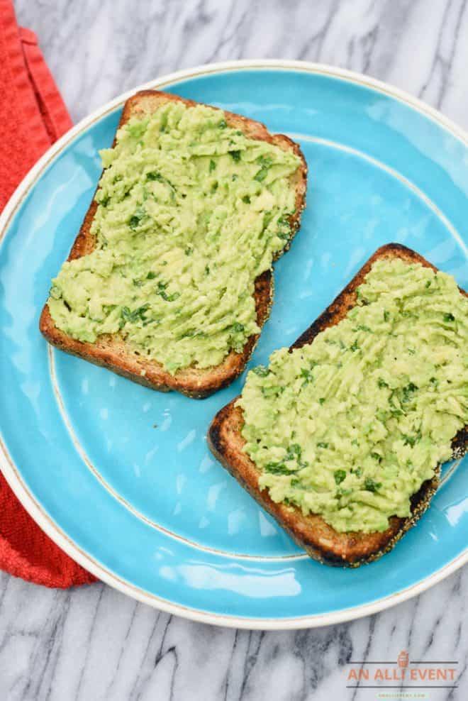 Top toasted multigrain bread with avocado mixture to make Avocado Toast.