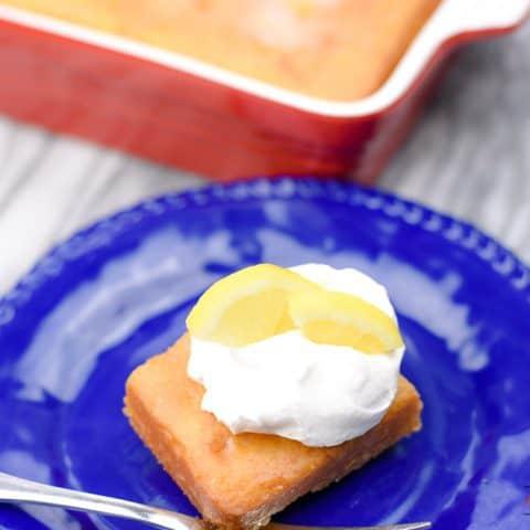 Lemonade Poke Cake Topped with Whipped Cream