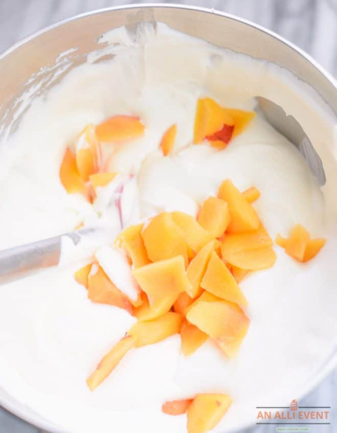 Mix whipped cream, peaches and sweetened condensed milk together