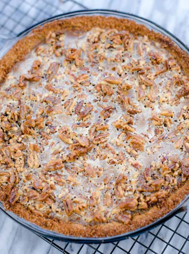 Sweet Potato Pie With Pecan Topping on Cooling Rack