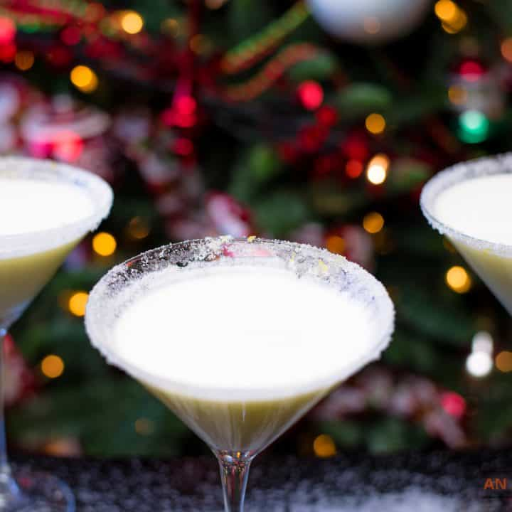 Three Mocktails In Front of Christmas Tree