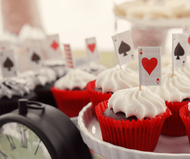 Chocolate Cupcakes With Vanilla Frosting and Picks With Playing Cards