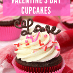 classic chocolate cupcakes topped with pink and white frosting and a chocolate word.