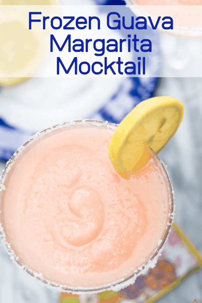 Frozen Guava Margarita Mocktail in glass with lemon wedge