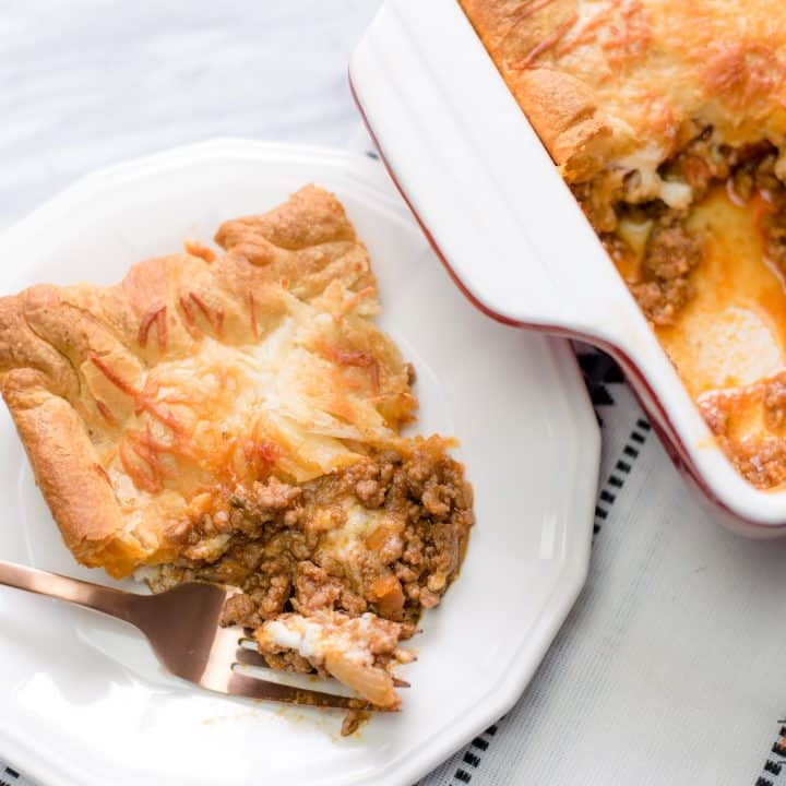 Ground Beef and Pasta Sauce Served with a Crescent Roll Crust and Parmesan Cheese