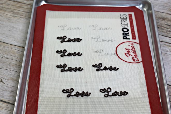 Love piped in chocolate on cookie sheet